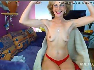 Hot granny flexes very sexy biceps on web cam