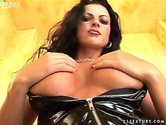 Voracious brunette in leather suit Juditta masturbates in the toilet