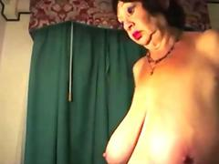 Black haired babe Dora Meszaros plugs a massive cock in her mouth