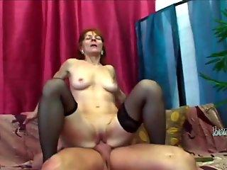 Hot granny is ready to taste throbbing young cock