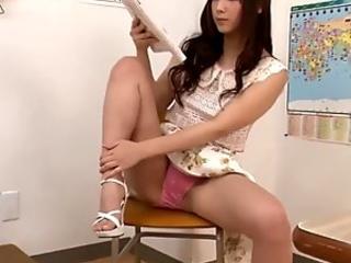 Cute Japanese teacher teases in her pink panties in classroom