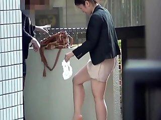 Asian hotties pissing outside