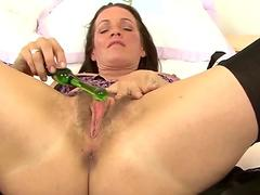 Marlyn pummels her labia with a fuck stick.