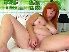 brit cougar Ginger Tiger fucktoys her juicy cunt