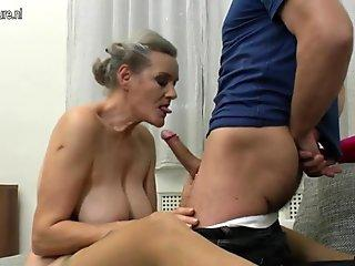 Busty mature tugging cock in POV