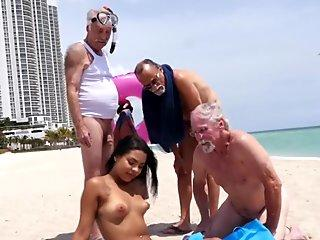 Horny grandpa s take a stroll to the beach to find a new chick