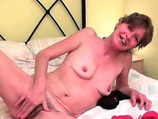 Hairy granny gets her saggy tits and furry hole fondled