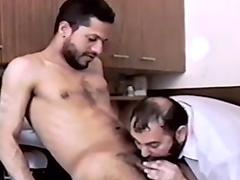 Stud showing his blowjob skills in retro gay video