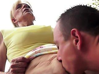 Laura Lion gets sprayed with a fresh load of cum on her huge juggs