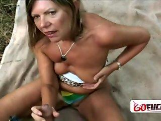 Busty blonde granny gets banged outdoors by horny younger dude